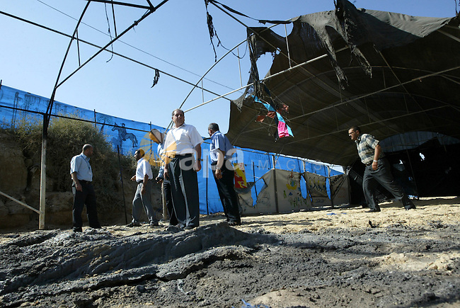 UN Relief and Works Agency (UNRWA) staff members inspect damages at a summer camp which was set on fire overnight by masked gunmen in Deir al-Balah center Gaza strip on June 28, 2010. Photo by Ashraf Amra