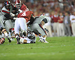 Ole Miss linebacker Denzel Nkemdiche (4) forces Alabama quarterback AJ McCarron (10) to fumble at Bryant-Denny Stadium in Tuscaloosa, Ala. on Saturday, September 29, 2012. Alabama won 33-14. Ole Miss falls to 3-2.