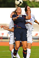 Abby Wambach wins a header vs. two Iceland opponents.  The USWNT defeated Iceland (2-0) at Vila Real Sto. Antonio in their opener of the 2010 Algarve Cup on February 24, 2010.