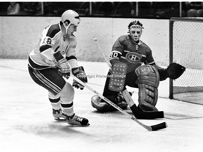 Seals Gary Croteau puts shot on Canadiens goalie Phil Myre.   (1970 photo/Ron Riesterer)