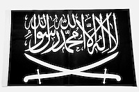The black flag associated with Jihad or Al Raya - it has been a symbol of of religious fighting and battles since the founding of Islam in the 7th century. The Prophet Muhamed and many of his companions are said to have carried a similar black flag into battle.<br /> It is among items of clothing and objects found in an Islamic clothing and accessory shop in the Bagicilar district of Istanbul.