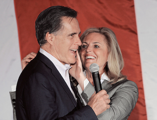 Zanesville, Ohio: March 5, 2012<br /> <br /> Ann Romney wipes her lipstick off the face of her husband and presidential candidate Mitt Romney during a campaign rally at Bryan Place. She had kissed him moments earlier. Romney is running a second time for the presidency. &copy;Chris Fitzgerald / CandidatePhotos