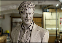 BNPS.co.uk (01202 558833)<br /> Pic: PhilYeomans/BNPS<br /> <br /> The return of the Thin White Duke...The statue catches an uncanny likeness to the legendary recording artist.<br /> <br /> The world's first statue of David Bowie is taking shape in sculpter Andrew Sinclair's Devon studio.<br /> <br /> Ever since the music legend's death in January 2016 there has been a clamour for a fitting tribute of Bowie to be made.<br /> <br /> While his birthplace of Brixton, south London, has been cited as the most likely location for one it is actually Aylesbury in Buckinghamshire that will lay claim to having the very first statue of him.<br /> <br /> The market town was where Bowie played an experimental gig in 1971 to see if had the confidence to perform live and then a year later where his alter-ego of Ziggy Stardust was born.<br /> <br /> One half of the statue has been completed by artist Andrew Sinclair. It depicts a handsome Bowie in his 'Blue Suit' period in the 1990s.