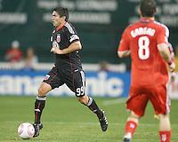 Jaime Moreno #99 of D.C. United moves away from Dan Gargan #8 of Toronto FC during an MLS match that was the final appearance of D.C. United's Jaime Moreno at RFK Stadium, in Washington D.C. on October 23, 2010. Toronto won 3-2.