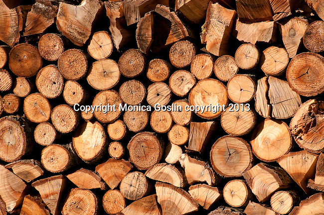 Neatly stacked wall of firewood in Soglio, Switzerland a town the Bregaglia Valley which dates back to 1219 and is said to be one of the most picturesque towns in Switzerland; Graubunden Canton