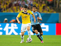 James Rodriguez of Columbia and Alvaro Gonzalez of Uruguay