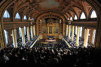 Tony Blair at Yale University speaking with President Richard Levin, Paul Kennedy & Lita Tandon '10 on Sept. 19, 2008 in Woolsey Hall. Wide angle overview of Woolsey Hall, the audience in the balcony and the stage, centered.