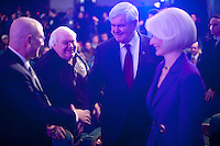 Republican presidential candidate Newt Gingrich, center, joined by his wife Callista Gingrich, right, arrives to speak at the Veterans for a Strong America presidential forum on Saturday, December 10, 2011 in Des Moines, IA.