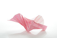 New York, NY, USA - November 4, 2011: An Origami spiral, based on a design by the Japanese Origami artist Tomoko Fuse, folded from one sheet of striped paper by Esme Cribb.