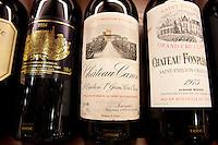 Fine wines Chateau Canon, Chateau Fonplegade, Chateau Palmer Medoc in wine merchants shop in St Emilion, Bordeaux, France