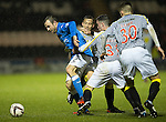 St Mirren v St Johnstone...06.12.14   SPFL<br /> Dave Mackay is held by Marian Kello and Steven Mallan<br /> Picture by Graeme Hart.<br /> Copyright Perthshire Picture Agency<br /> Tel: 01738 623350  Mobile: 07990 594431