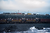 Train carriages laden with coal sit at a coal mine depot next of Ghanudih in Jharia, outside of Dhanbad in Jharkhand, India.  Photo: Sanjit Das/Panos