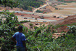 Pedro Ignacio Guzman, from La Cerca, watches from a hill the construction of the El Llagal tailings pond. Nearly completed, the industrial reservoir will hold the toxic waste from Barrick and Goldcorp's Pueblo Viejo open-pit gold mine. Cotuí, Sánchez Ramírez, Dominican Republic. April 2012.