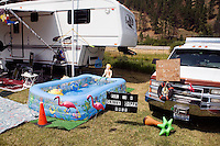 A sign next to a pool outside a trailer declares the pool is for skinny dipping only at the Testicle Festival at the Rock Creek Lodge in Clinton, MT.  The Rock Creek Lodge in Clinton, MT, has hosted the annual Testicle Festival since the early 1980s.  The four day festival and party revolves around the consumption of so-called Rocky Mountain Oysters, which are deep-fried bull testicles.