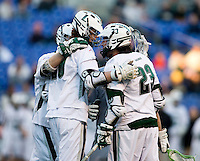 Collin Finnerty (20) celebrates his goal with D.J. Comer (23) and other Loyola teammates during the Face-Off Classic in at M&T Stadium in Baltimore, MD