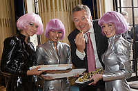 Nottingham business solicitor Austin Moore, a partner at HBJ-Gateley Wareing in the city, samples a party nibble from the futuristic waitress girls at a client event, held at Nottingham Council House.
