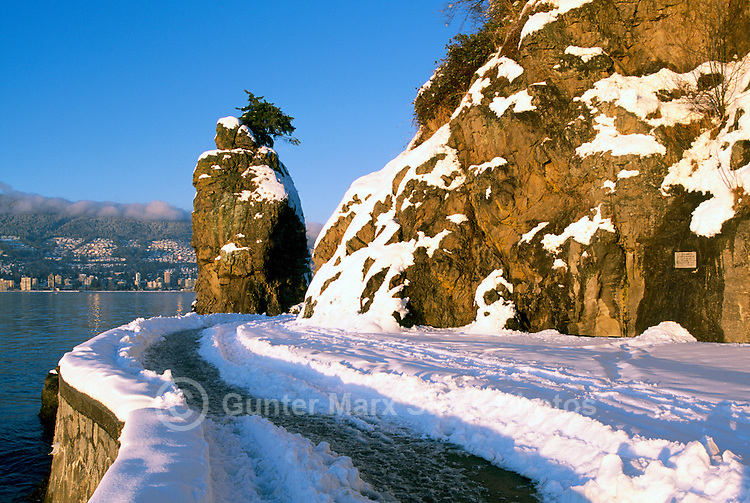 """Stanley Park, Vancouver, BC, British Columbia, Canada, Winter - Snow Covered """"Siwash Rock"""" and Stanley Park Seawall at English Bay"""
