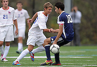 HYATTSVILLE, MD - OCTOBER 26, 2012:  James Gielen (26) of DeMatha Catholic High Schoolslips the ball past Arjan Ganji (10) of St. Albans during a match at Heurich Field in Hyattsville, MD. on October 26. DeMatha won 2-0.