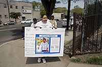 Newark, USA. 07th May 2014. Wendy and her family members attend protest calling for end to deportations of her husband, outside a detention center office in New Jersey. Kena Betancur/VIEWpress