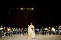 22 April 2006 - New York City, NY - Reverend Canon Thomas A. Miller (foreground) addresses an audience of cyclists during the annual blessing of the bicycles at the Cathedral of St John the Divine in New York City, USA, 22 April 2006. Several dozens cyclists, professional and recreational, and a few roller skaters attended the ceremony  during which prayers are said for those who died in cycling accidents this year and for a safe season. Photo Credit: David Brabyn