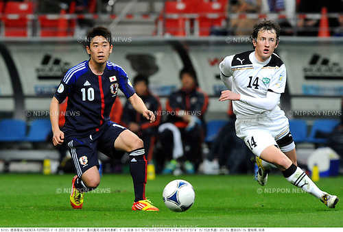 Shinji Kagawa (JPN), Stanislav Andreev (UZB),.FEBRUARY 29, 2012 - Football / Soccer :.2014 FIFA World Cup Asian Qualifiers Third round Group C match between Japan 0-1 Uzbekistan at Toyota Stadium in Aichi, Japan. (Photo by Takamoto Tokuhara/AFLO)
