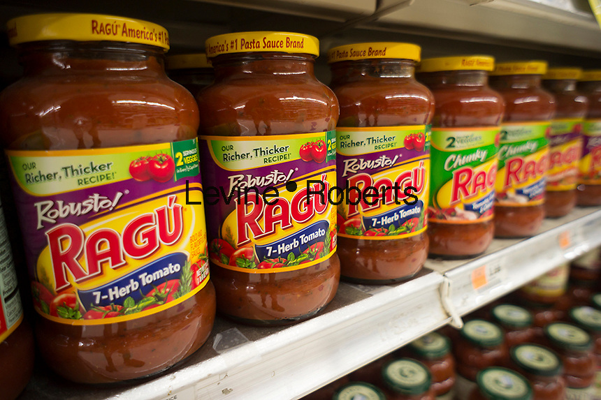 Jars of Unilever's Ragu pasta sauce on a supermarket shelf in New York on Friday, May 23, 2014. Unilever, has agreed to sell its Ragu and Bertiolli brands  to the Mizkan Group, a Japanese condiment manufacturer in a deal worth approximately $2.15 billion. Unilever  has been reshaping its portfolio of food products and has already sold its Skippy and Wish-Bone brands.(© Richard B. Levine)