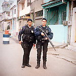 Patrol Officers Dilma Carvalho, 32, and Carla Bonn, 33, right.<br /> Rapid Response Team<br /> Pacifying Police Unit<br /> Complexo do Caju, Rio de Janeiro, Brazil