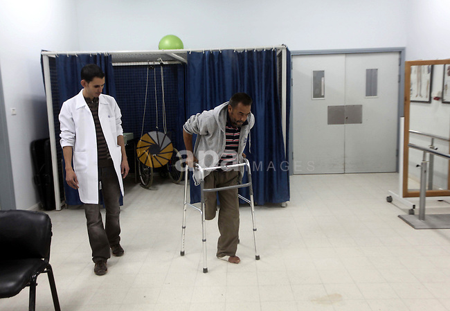 Abd El-Fatah Hassouna, Palestinian man who lost his leg, during rehabilitation sport in Gaza city, on Dec. 03, 2012. International Day of People with Disability, is an international observance promoted by the United Nations since 1992. It has been celebrated with varying degrees of success around the planet. The observance of the Day aims to promote an understanding of disability issues and mobilize support for the dignity, rights and well-being of persons with disabilities. Photo by Ashraf Amra