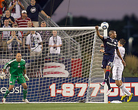 DC United midfielder Branko Boskovic (27) heads ball on net as New England Revolution defender Darrius Barnes (25) defends and New England Revolution goalkeeper Matt Reis (1) reacts. The New England Revolution defeated DC United, 1-0, at Gillette Stadium on August 7, 2010.