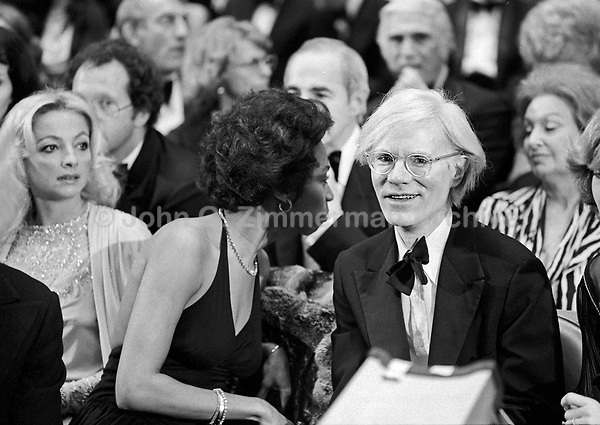 """Andy Warhol (R) and Donyale Luna (head turned) at the """"Circus of the Stars,"""" (CBS Special), Santa Monica Civic Auditorium, November, 1976. Photo by John G. Zimmerman"""