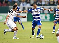 CARSON, CA – August 6, 2011: LA Galaxy defender Omar Gonzalez (4) and FC Dallas forward Maicon Santos (9) during the match between LA Galaxy and FC Dallas at the Home Depot Center in Carson, California. Final score LA Galaxy 3, FC Dallas 1.