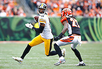 Martavis Bryant #10 of the Pittsburgh Steelers runs after the catch in front of Dre Kirkpatrick #27 of the Cincinnati Bengals in the first half during the game at Paul Brown Stadium on December 12, 2015 in Cincinnati, Ohio. (Photo by Jared Wickerham/DKPittsburghSports)