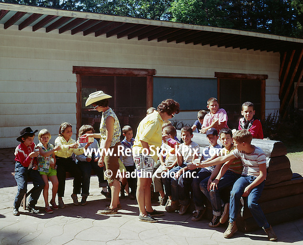 Victor Van's Hideaway Ranch / Shadow Mountain in East Jewett, New York. Ladies pouring milk to children in day camp at the ranch.