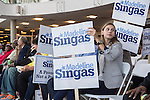 At the Nassau County Democrats nominating convention, audience members hold up signs for Madeline Singas, who is running for Nassau County District Attorney. Singas, who became Acting Nassau County DA when D.A. Rice resigned to join Congress, is one of 55 candidates the executive committee nominated for races.