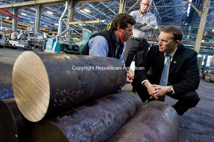 WATERBURY, CT - 02 MARCH 2010 -030210JT13--<br /> John Barto, president of Ansonia Copper and Brass, speaks to U. S. Rep. Chris Murphy (D-5th) about the copper nickel blocks before them as Jeff Lawlor, director of sales, stands behind them as Murphy took a tour of the Waterbury facility on Tuesday.<br /> Josalee Thrift Republican-American