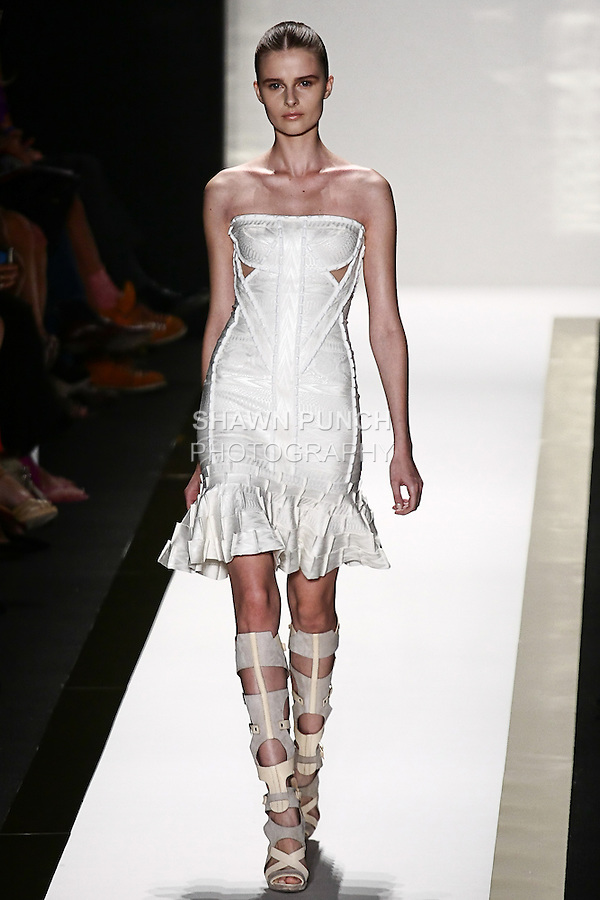 Vasilisa walks the runway in an alabaster foil bandage dress with beading detail, and vapor gladiator boot, by Max Azria for the Herve Leger by Max Azria Spring 2012 fashion show, during Mercedes-Benz Fashion Week Spring 2012.