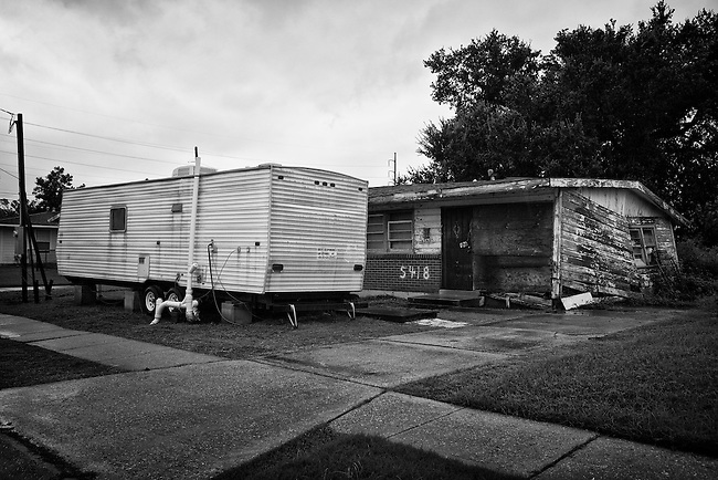This Fema trailer is still occupied while this family's uninhabitable house sits in a state of disrepair on their property in Pontchartrain Park in Gentilly, New Orleans five years after being damaged by Hurricane Katrina. Photo by Skip Bolen.