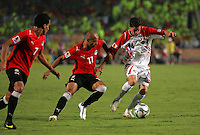 Costa Rica's Bryan Oviedo (14) attempts to keep the ball away from Egypt's Aly Mohamed (7), and Afroto (11) during the FIFA Under 20 World Cup Round of 16 match at the Cairo International Stadium on October 06, 2009 in Cairo, Egypt.