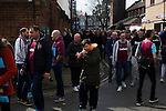 West Ham United 2 Crystal Palace 2, 02/04/2016. Boleyn Ground, Premier League. Fans making their way towards the ground along Castle Street at the Boleyn Ground before West Ham United hosted Crystal Palace in a Barclays Premier League match. The Boleyn Ground at Upton Park was the club's home ground from 1904 until the end of the 2015-16 season when they moved into the Olympic Stadium, built for the 2012 London games, at nearby Stratford. The match ended in a 2-2 draw, watched by a near-capacity crowd of 34,857. Photo by Colin McPherson.