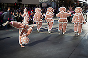 Gingerbread march backward in the Raleigh Christmas Parade. View a slideshow of the parade at indyweek.com