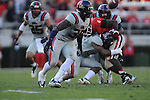 Ole Miss linebacker Denzel Nkemdiche (4) hits Georgia tailback Keith Marshall (4), forcing a fumble, at Sanford Stadium in Athens, Ga. on Saturday, November 3, 2012.