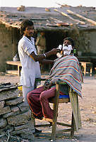 Street Barber, Delhi, India.