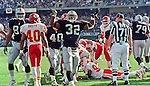 Oakland Raiders vs. Kansas City Chiefs at Oakland Alameda County Coliseum Sunday, November 5, 2000.  Raiders beat Chiefs  49-31.  Oakland Raiders full back Zack Crockett (32) celebrates touchdown.