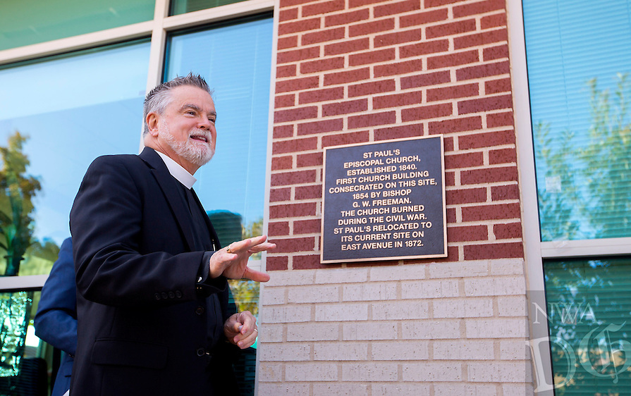 NWA Democrat-Gazette/JASON IVESTER <br /> The Rev. Lowell Grisham helps unveil a plaque on Wednesday, Oct. 7, 2015, commemorating the original site of St. Paul&rsquo;s Episcopal Church at the First Security Bank in Fayetteville. In 1854, a frame church building at the corner of what is now College and Meadow &ndash; the current location of First Security Bank &ndash; was dedicated.