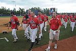 Mississippi players walk back to the dugout following an NCAA Regional game at Davenport Field in Charlottesville, Va. on Sunday, June 6, 2010. St. John's won 20-16.