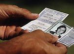 A U.S. Border Patrol agent in Del Rio, Texas checks the identification card of a Mexican day worker.  While the traditional mission of the United States Border Patrol has always been the detection and prevention of the illegal entry of aliens and smuggling of illegal contraband into the United States anywhere other than a designated port-of-entry, the dawn of the age of terrorism within our nation has added a new and high priority mission: to detect and prevent the entry of terrorists and their weapons into the United States. Jim Bryant Photo..©2006. All Rights Reserved.