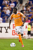 Macoumba Kandji (9) of the Houston Dynamo. The New York Red Bulls defeated the Houston Dynamo 2-0 during a Major League Soccer (MLS) match at Red Bull Arena in Harrison, NJ, on August 10, 2012.