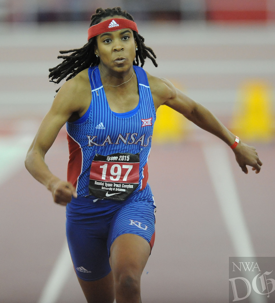 NWA Democrat-Gazette/ANDY SHUPE - Former Fayetteville High School and current Kansas standout Sydney Conley (center) comes in to the finish line while competing in the 60 meters during the Tyson Invitational Friday, Feb. 13, 2015, at the Randal Tyson Track Center in Fayetteville.