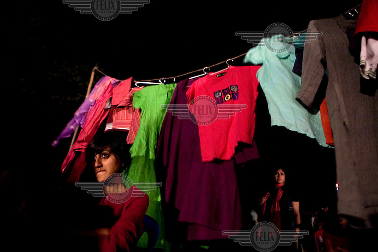 Women participate in a protest against the recent attacks on women in Karnataka, on International Women's Day in Bangalore. They hung up clothes that the girls were attacked in to show that they were not only wearing western clothes, but regular Indian clothes as well.