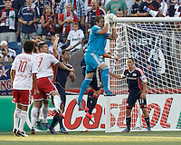 New England Revolution goalkeeper Bobby Shuttleworth (34) grabs a corner kick on his way to a shut out. In a Major League Soccer (MLS) match, New England Revolution defeated New York Red Bulls, 2-0, at Gillette Stadium on July 8, 2012.